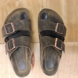 cute pair brown leather birkenstock 2-strap